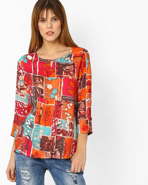 Printed Top With Curved Hem By Global Desi ( Coral )