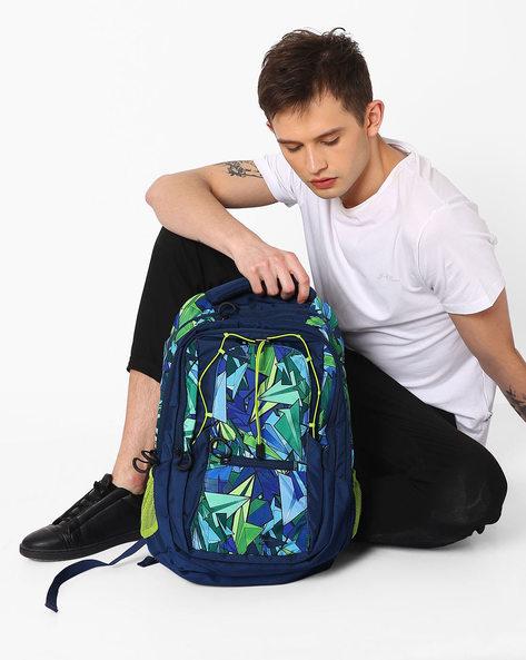 Printed Wiki Wide Wings Water-Resistant Backpack By Wildcraft ( Blue )