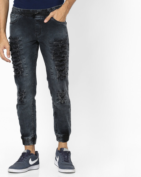 Heavily Washed Distressed Denim Joggers By DEEZENO ( Black )