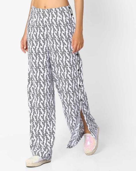 Printed Flared Pants With Side Slits By AJIO ( Black )