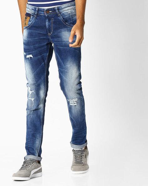 Lightly Washed Distressed Skinny Jeans By SPYKAR ( Darkblue )