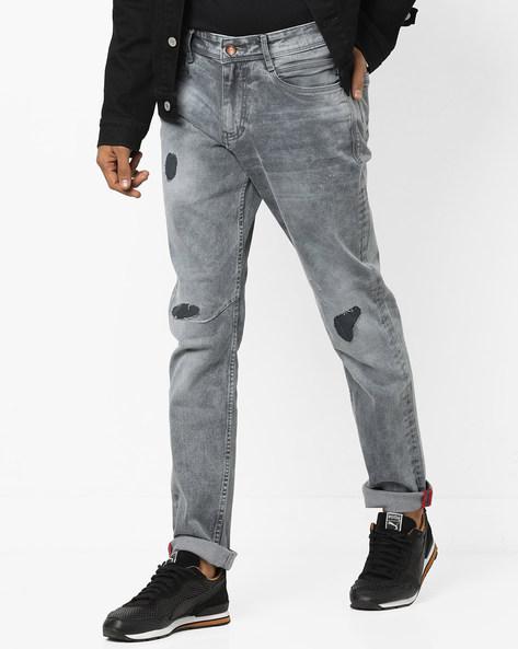 Lightly Washed Distress Jeans By AJIO ( Grey )