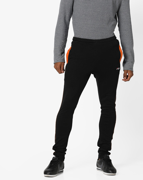 Relaxed Fit Track Pants With Contrast Stitch By FILA ( Black )