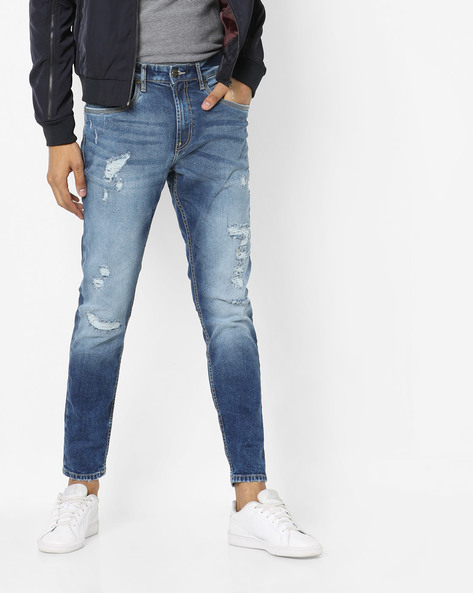 Heavily Washed Distressed Slim Jeans By Locomotive ( Blue )