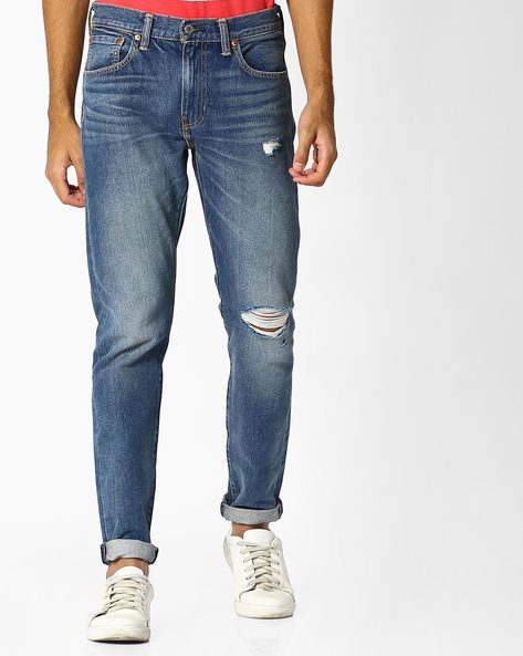 Lightly Distressed Slim Fit Jeans By LEVIS ( Blue )
