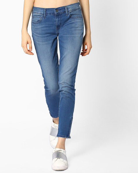 Lightly Washed Skinny Denims By LEVIS ( Blue )