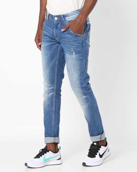 Washed & Distressed Skinny Jeans By SPYKAR ( Blue )