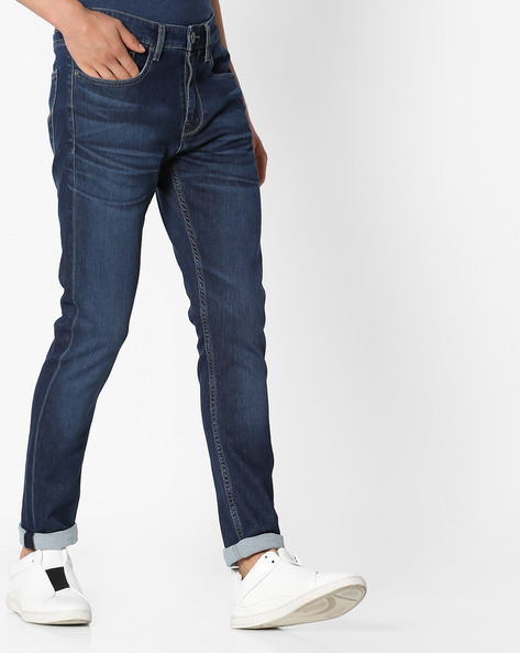 Heavily Washed Slim Fit Jeans By Pepe Jeans ( Red )