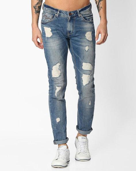 Heavily Distressed Skinny Jeans By SPYKAR ( Lightblue )