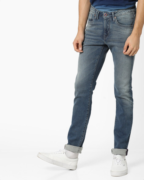 Mid-Rise Slim Fit Jeans By FLYING MACHINE ( Assorted )