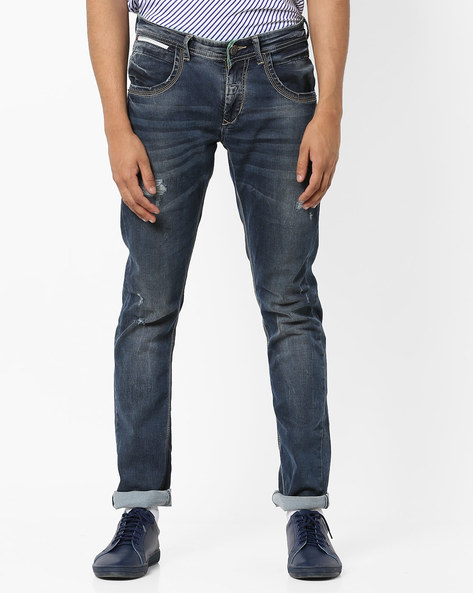 Lightly Washed Distressed Skinny Jeans By SPYKAR ( Dkblue )