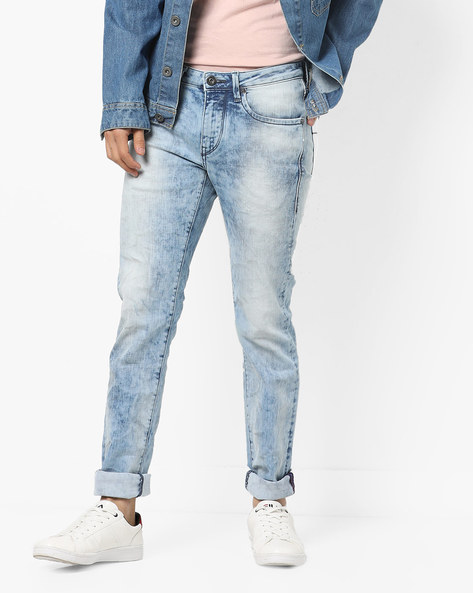 Heavily Washed Slim Fit Jeans By FLYING MACHINE ( Assorted )