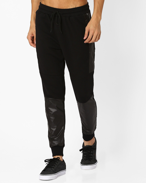 Panelled Knit Joggers With Zip Pocket By AJIO ( Black )
