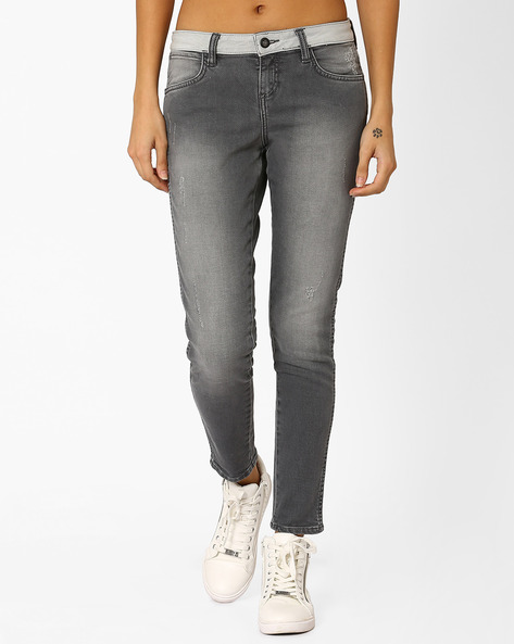 Lightly Washed Skinny Jeans By WRANGLER ( Grey )