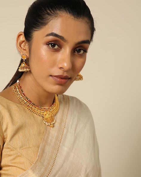 Goddess Lakshmi Necklace Set In Stone And Pearl By Spargz ( Gold )