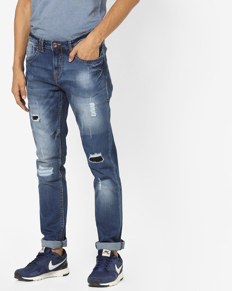 Mid-Washed Distressed Jeans By FLYING MACHINE ( Blue )
