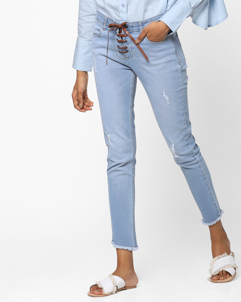 Ajio Offer Get Women's Jeans & Trousers under Rs.1,299 Lightly Washed Jeans with Tie-up Rs. 810