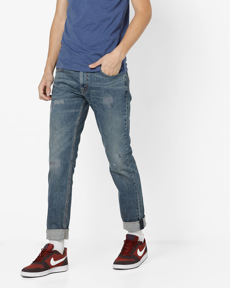511 Lightly Washed Slim Distressed Jeans By LEVIS ( Blue )