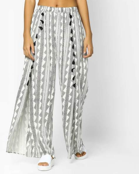 Printed Palazzos With Tassels By FUSION BEATS ( Cream )