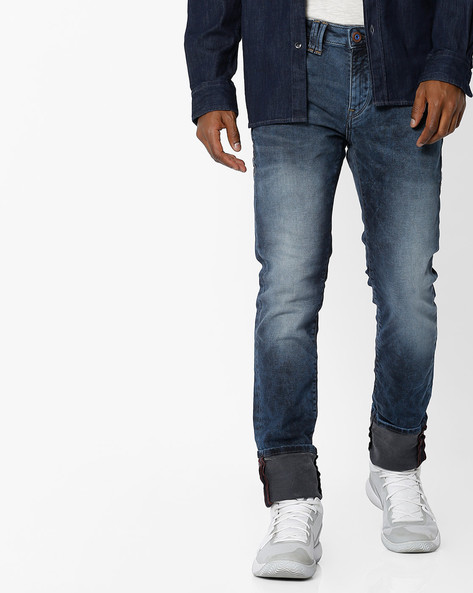 Mid-Wash Mid-Rise Tapered Jeans By FLYING MACHINE ( Assorted )