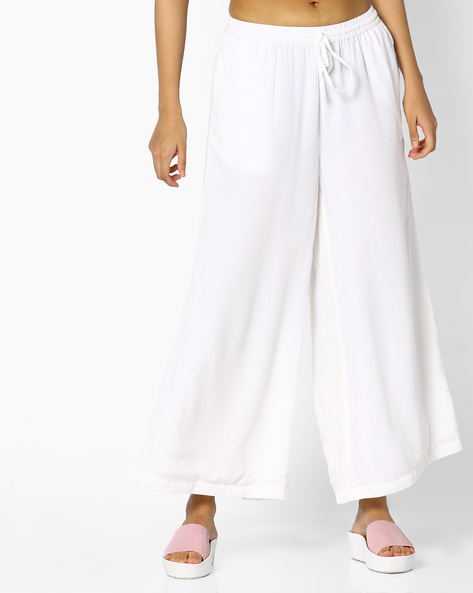 Flared Palazzos With Drawstring Waist By PE IW Fusion ( White )