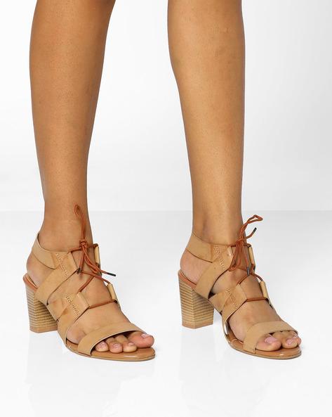 8bd54f9d4c 54% OFF on AJIO Tie-up Block Heel Sandals on Ajio.com   PaisaWapas.com