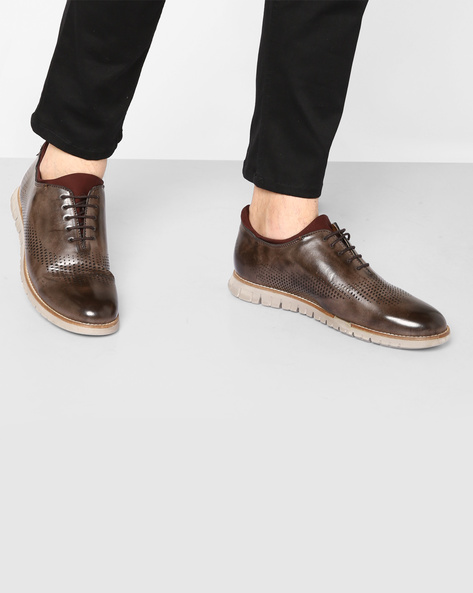 Wholecut Casual Shoes With Laser Cut-Outs By TURN ( Brown )