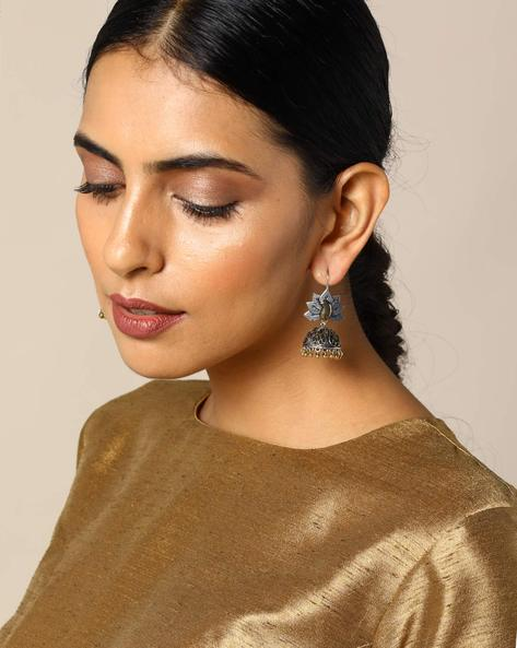Two-Toned Floral Brass Jhumka Earrings By Studio B40 ( Goldensilver )