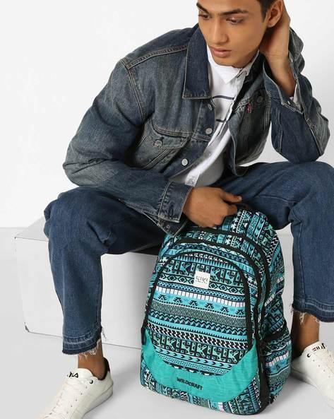 Printed Backpack With Adjustable Shoulder Straps By Wildcraft ( Blue )