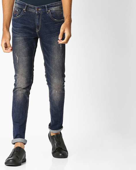 Lightly Washed Distressed Skinny Jeans By SPYKAR ( Multi )