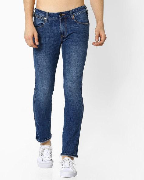 Skanders Lightly Washed Slim Fit Jeans By WRANGLER ( Blue )
