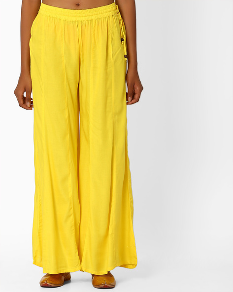 Palazzo Pants With Tassel Tie-Up By Khimsariya ( Yellow )