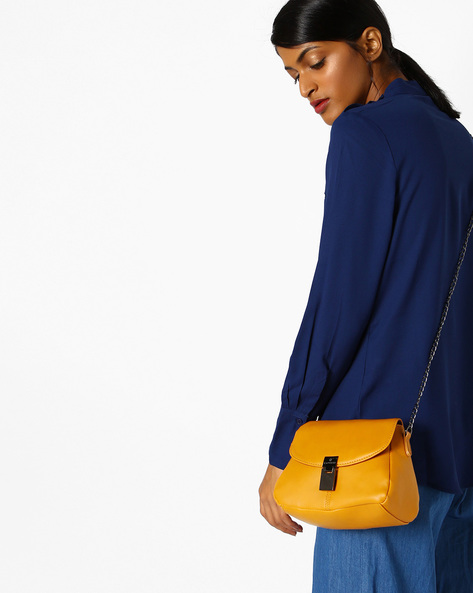 Nelly Sling Bag With Snap-Button Flap By CAPRESE ( Orange )