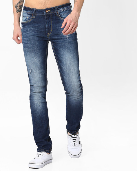 Lightly Washed Distressed Slim Jeans By AJIO ( Blue )