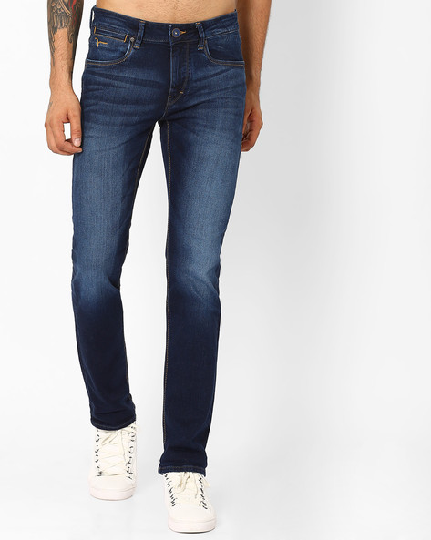 Lightly Washed Slim Michael Jeans By FLYING MACHINE ( Assorted )