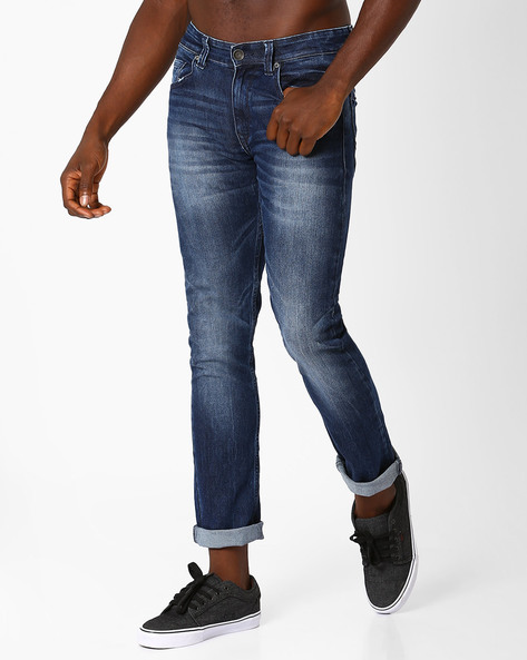Lightly Washed Tapered Fit Jeans By SPYKAR ( Dkblue )