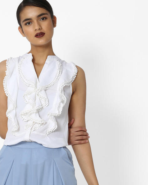Sleeveless Ruffled Top With Bobble Trim By Oxolloxo ( Ivory )