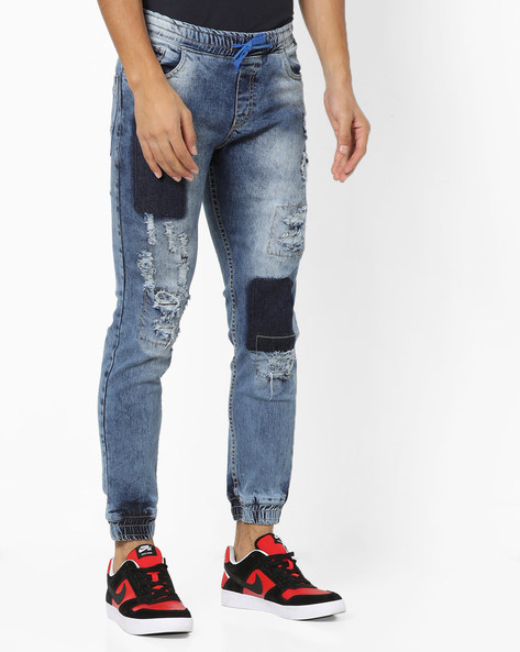Mid-Washed Distressed Denim Joggers By DEEZENO ( Grey )
