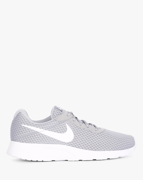 Tanjun Lace-Up Running Shoes By NIKE ( Grywht )