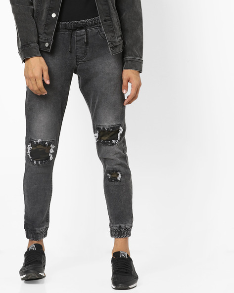 Lightly Washed Distressed Denim Joggers By DEEZENO ( Blue )