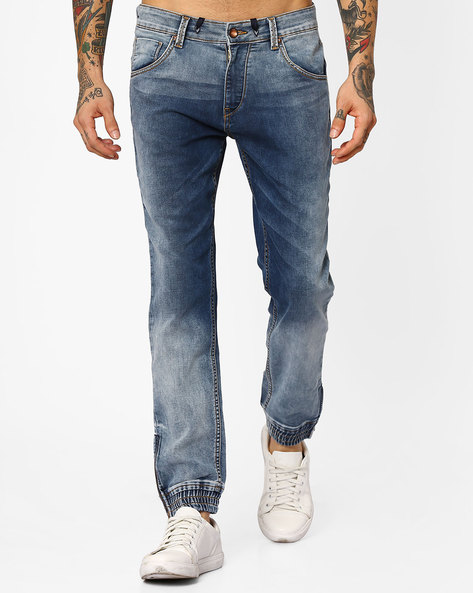 Heavily Washed Jogger Jeans By AJIO ( Lightblue )