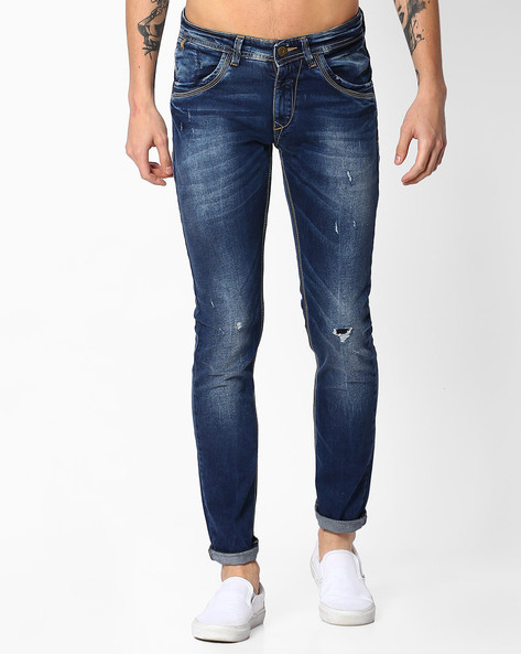 Lightly Washed Skinny Fit Distressed Jeans By SPYKAR ( Dkblue )