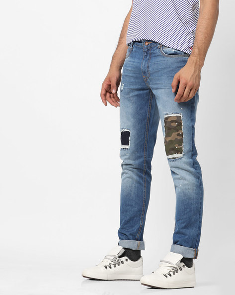 Mid-Rise Tapered Distressed Jeans By AJIO ( Blue )