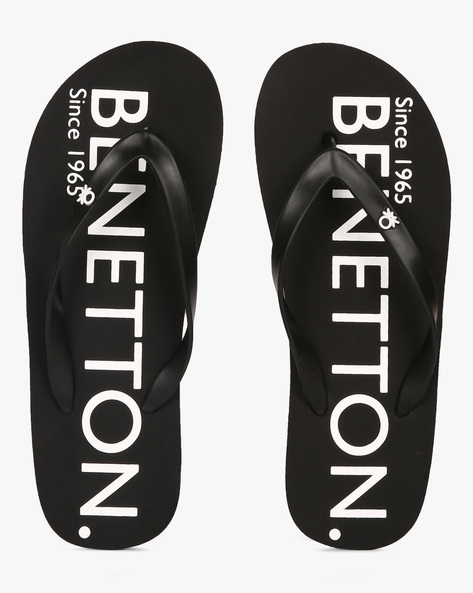 Thong-Style Flip-Flops With Printed Branding By UCB ( Black )
