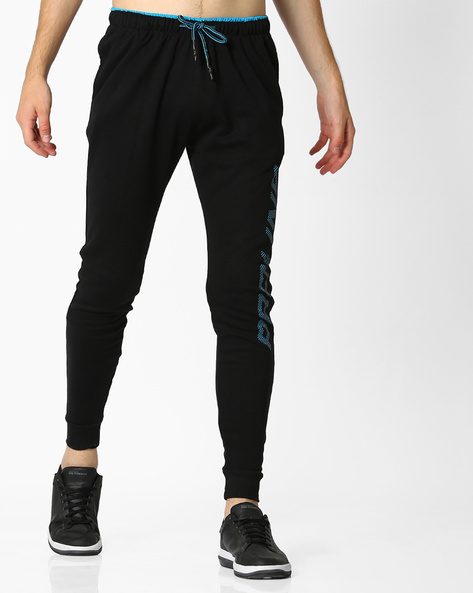 Mid-Rise Joggers With Drawstring Fastening By PROLINE ( Black )