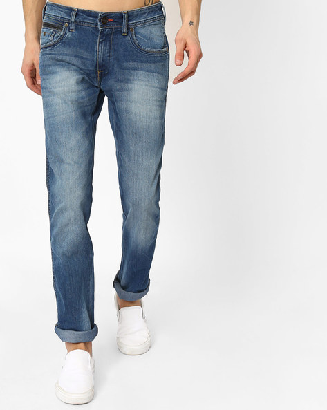 Lightly Washed Slim Fit Jeans By WRANGLER ( Blue )